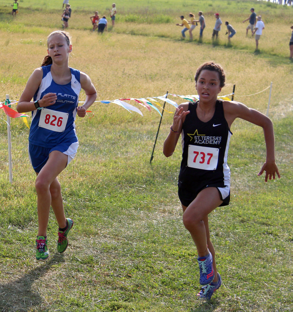 ROSS MARTIN/Citizen photo West Platte sophomore Lexi Elmore, left, finished fourth in the Platte County Invitational.