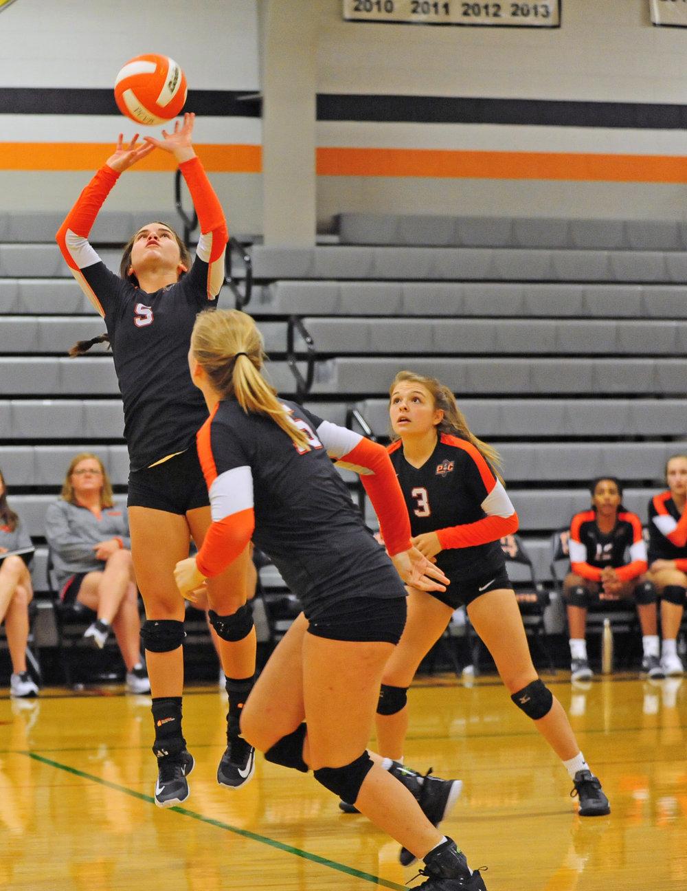 NICK INGRAM/Citizen photo Platte County sophomore Ashley Bell (5) hits a set for senior Lauren Walker (front).