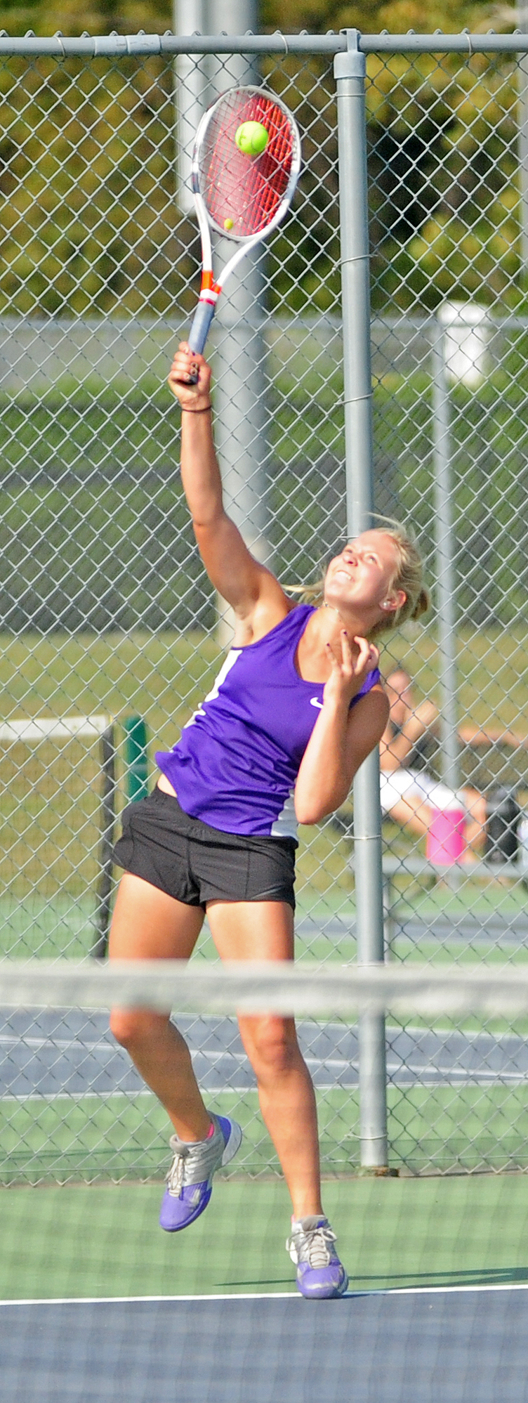 NICK INGRAM/Citizen photo Park Hill South's Chloe Norris hits a serve during the No. 2 singles match against Park Hill on Thursday, Sept. 14 at Park Hill South High School in Riverside, Mo.