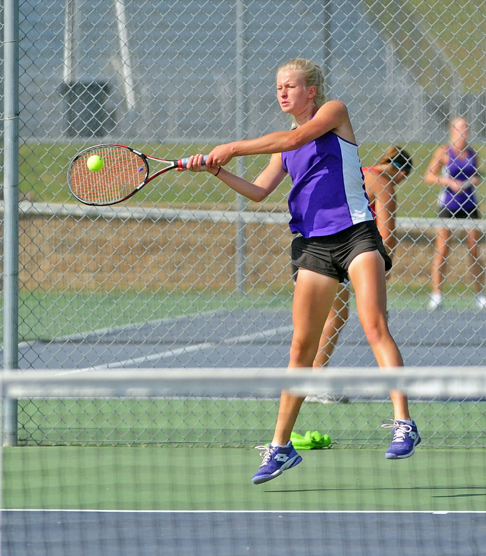 NICK INGRAM/Citizen photo Park Hill South's Abby Norris hits return shot during the No. 1 singles match against Park Hill on Thursday, Sept. 14 at Park Hill South High School in Riverside, Mo.