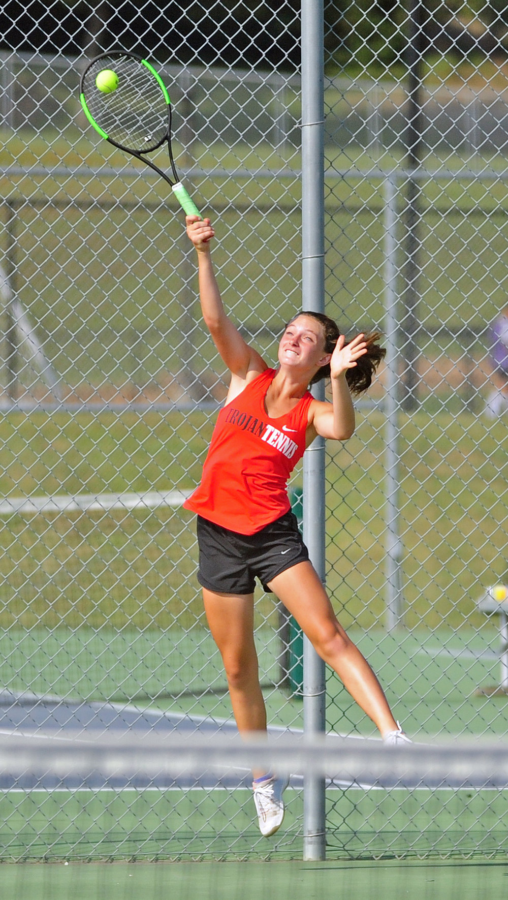 NICK INGRAM/Citizen photo Park Hill freshman Maisie Markowitz reaches up to hit a serve in the dual with Park Hill South on Thursday, Sept. 14.