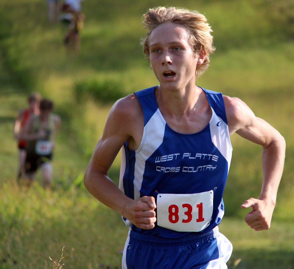 ROSS MARTIN/Citizen photo West Platte junior Max Davies comes around the final turn in the Platte County Invitational on Thursday, Sept. 14 at Platte Ridge Park.