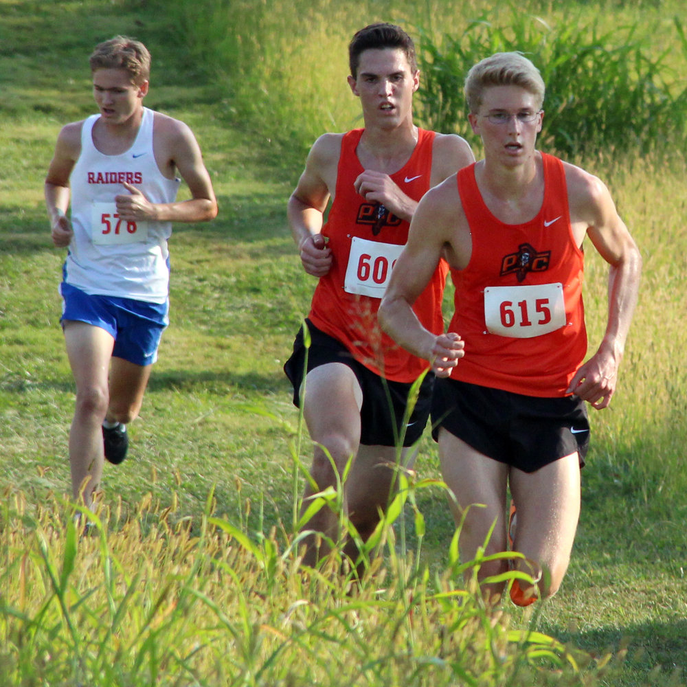 ROSS MARTIN/Citizen photo Platte County senior Nick Bjustrom (615) and junior Keegan Cordova (middle) come to the final turn on the course at Platte Ridge Park during the Platte County Invitational on Thursday, Sept. 14.