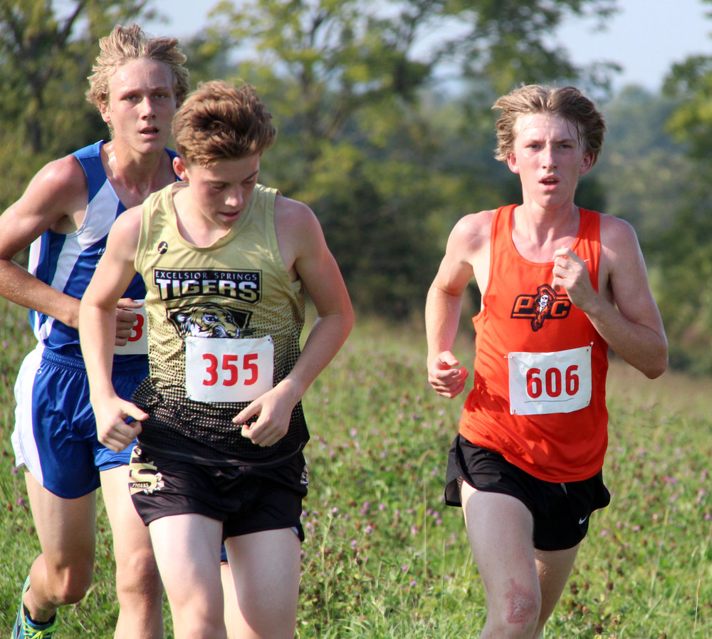 ROSS MARTIN/Citizen photo Platte County junior Jackson Letcher, right, leads a pack of three runners that also includes West Platte junior Max Davies, left.