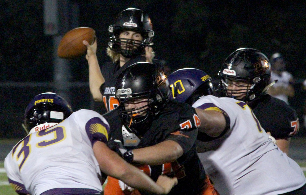 ROSS MARTIN/Citizen photo Platte County junior tackle Reid Sutter (74) and sophomore guard Max Renner (right) block for senior quarterback Tanner Clarkson.