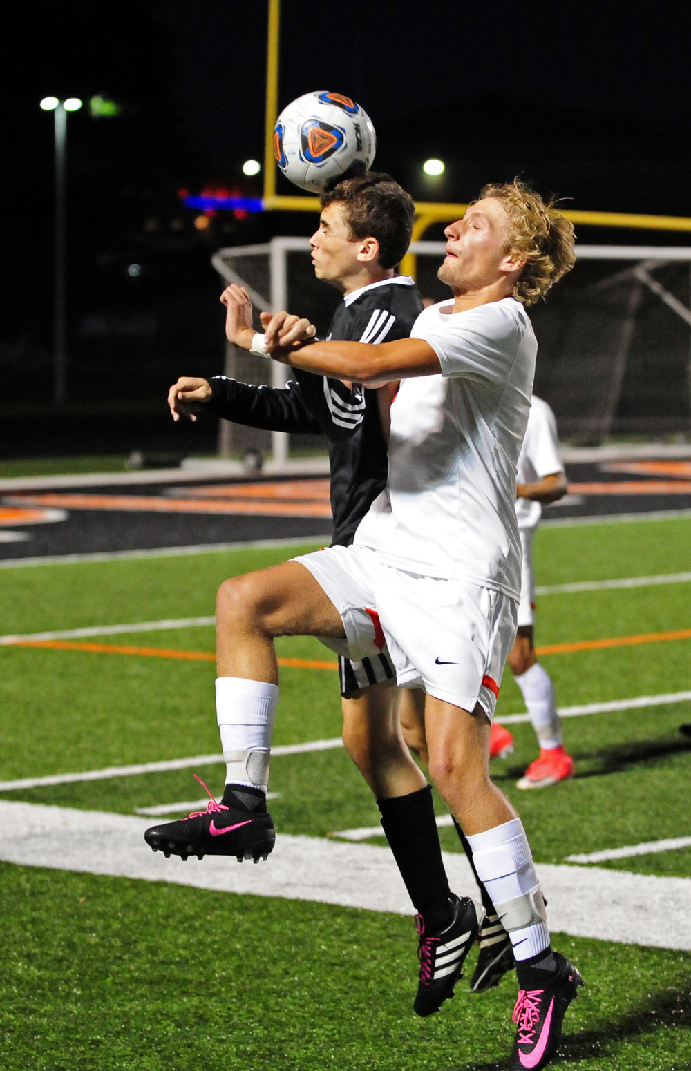 NICK INGRAM/Citizen photo Platte County junior Blake Cochran, front, fights for a loose ball with a Kearney defender.