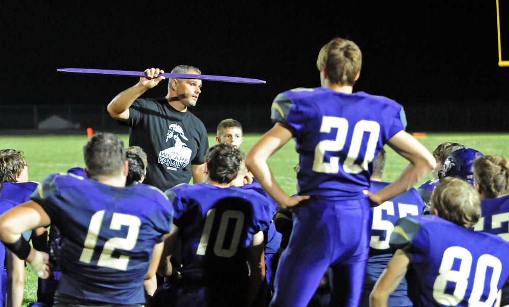 NICK INGRAM/Citizen photo North Platte coach Josh Rodriguez talks with his players after a 33-14 win over West Platte on Friday, Sept. 15 in Dearborn, Mo. earned them The Tobacco Stick traveling trophy.