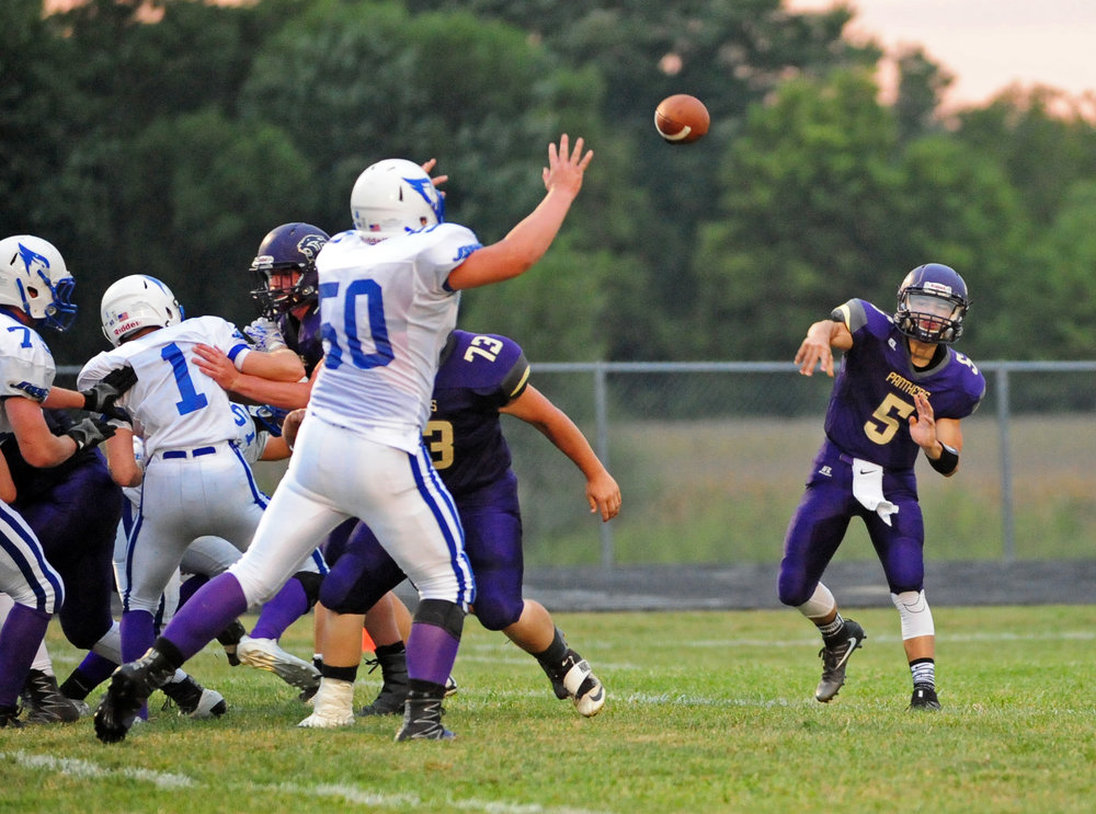 NICK INGRAM/Citizen photos North Platte sophomore Andrew Hernandez (5) throws a pass against West Platte on Friday, Sept. 15 in Dearborn, Mo.