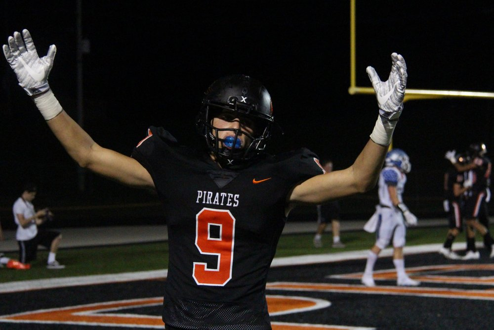 ROSS MARTIN/Citizen photo Platte County junior wide receiver Dylan Gilbert celebrates the Pirates' overtime touchdown in 35-28 victory over Liberty on Friday at Pirate Stadium.