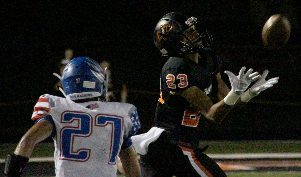 ROSS MARTIN/Citizen photo Platte County senior wide receiver John Watts, right, makes a catch in the Pirates' 35-28 victory Friday, Sept. 22 against Liberty at Pirate Stadium.