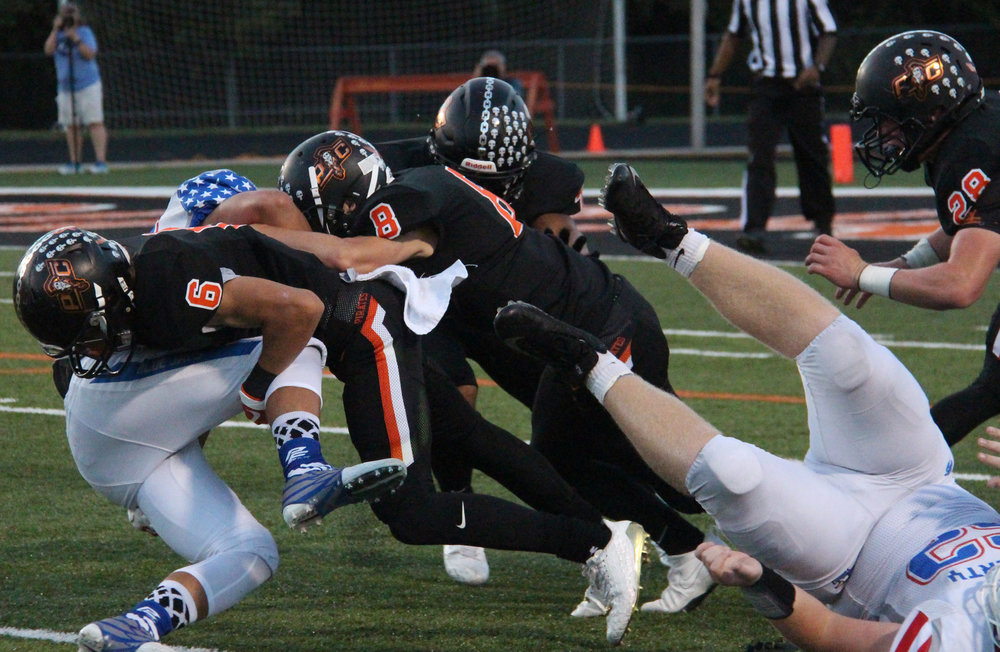 ROSS MARTIN/Citizen photo Platte County junior Nolan Saale (6) leads the charge on a tackle in the first half.