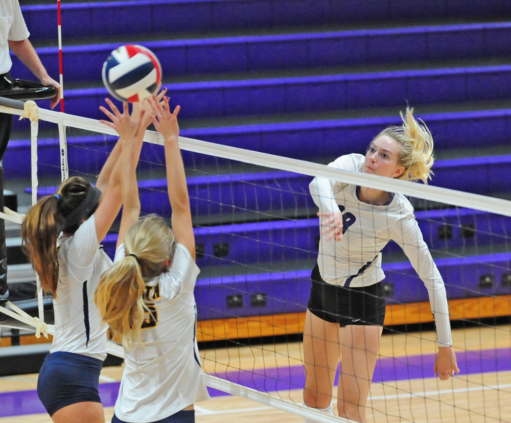 NICK INGRAM/Citizen photo Park Hill South senior Annika Welty, right, watches a spike she hit against Liberty North on Thursday, Sept. 21 at Park Hill South High School in Riverside, Mo.