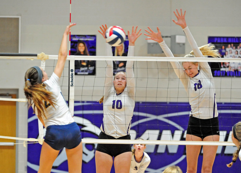 NICK INGRAM/Citizen photo Park Hill South senior Annika Welty, right, and sophomore Rachel Francis (10) go up for a block against Liberty North on Thursday, Sept. 21 at Park Hill South High School in Riverside, Mo.