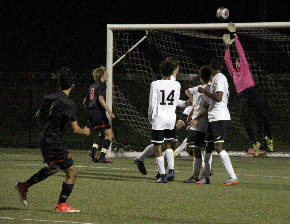 ROSS MARTIN/Citizen photo Platte County senior forward Chandler Peterson, left, watches as Park Hill South junior goalkeeper Mark Allred, right, saves a free kick during the second half of a Panther Classic pool game Monday, Oct. 2 at Park Hill District Soccer Complex in Riverside, Mo.