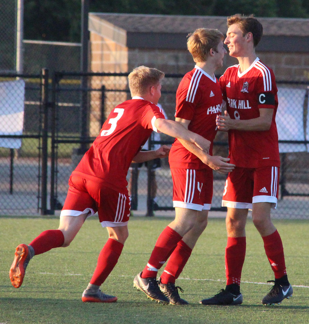 ROSS MARTIN/Citizen photo Park Hill sophomore Matt Lachowitzer, center, celebrates his first half goal against North Kansas City with teammates Jackson Turner, right, and Nick Bender on Monday, Oct. 2 at Park Hill District Soccer Complex in Riverside, Mo.