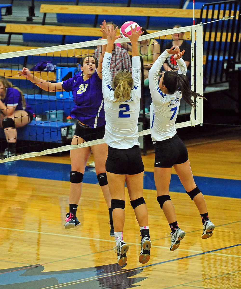 NICK INGRAM/Citizen photo North Platte sophomore McKenzie Brockhoff, left, tries to hit the ball past the defense of West Platte's Samantha Rotterman (2) and Tori Norman (7) during a match Monday, Oct. 2 at West Platte High School in Weston, Mo.