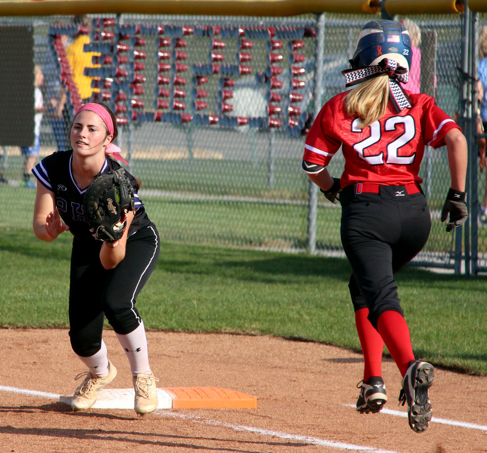 ROSS MARTIN/Citizen photo Park Hill South sophomore Jessie Hagen, left, records an out at first base with Park Hill's Jessie Binckley running during a game Monday, Oct. 2 at Park Hill High School in Kansas City, Mo.