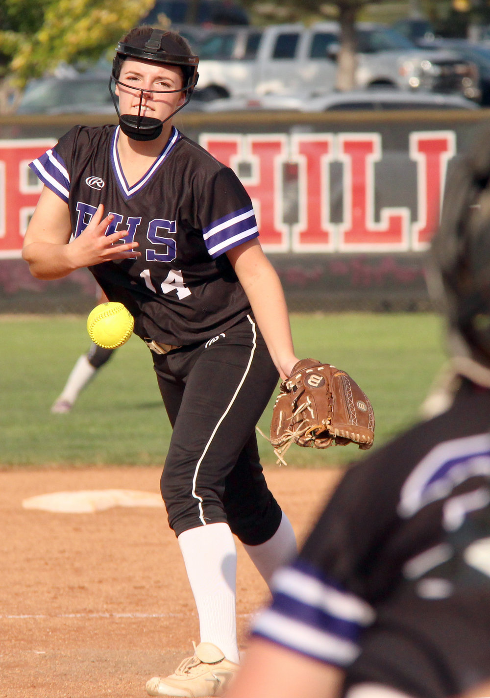 ROSS MARTIN/Citizen photo Park Hill South junior Gracie Dieleman, right, delivers a pitch to sophomore catcher Meggen Keller.