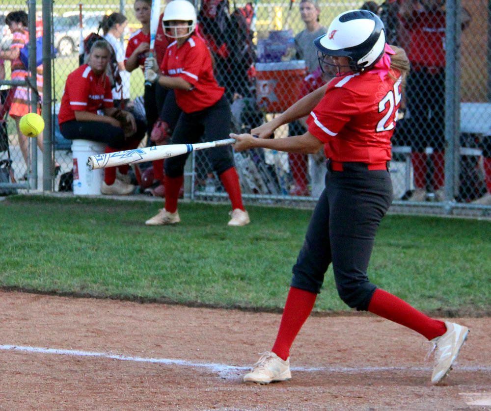ROSS MARTIN/Citizen photo Park Hill's Chloe Strickland hits a pitch against Park Hill South on Monday, Oct. 2.