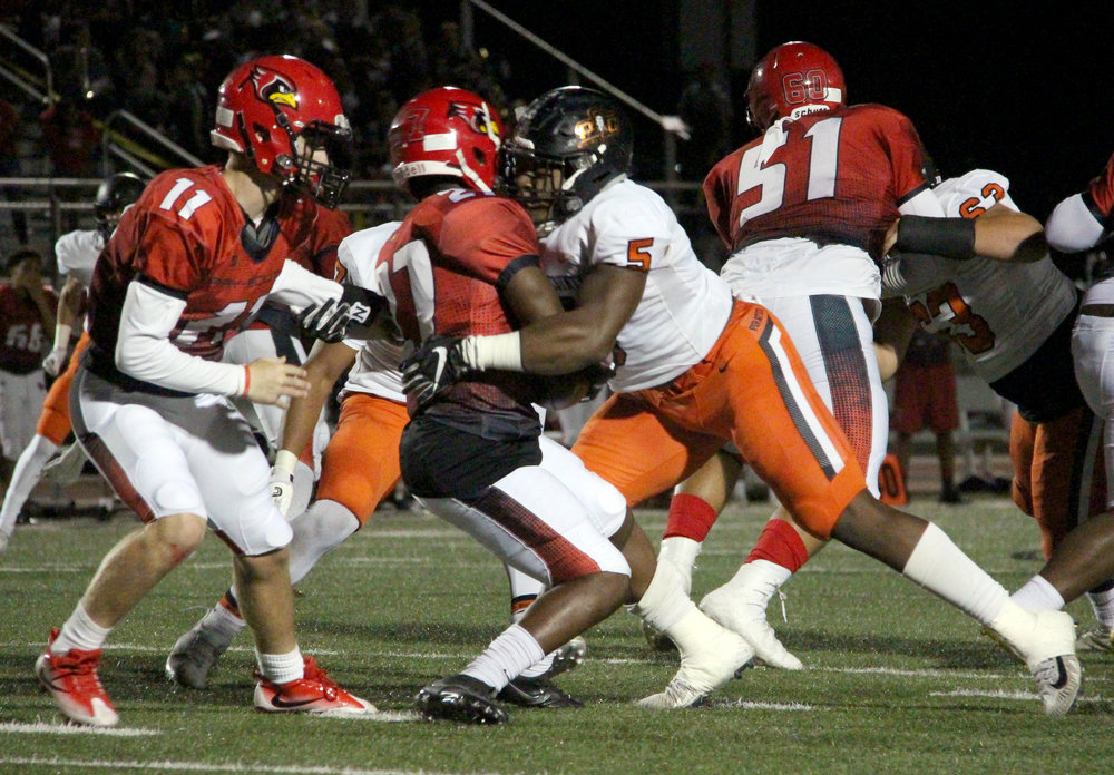 ROSS MARTIN/Citizen photo Platte County senior defensive end Michael Smith (5) stops Raytown South running back Tre Rhodes in the backfield during a Suburban Conference Blue Division game Friday, Sept. 29 in Raytown, Mo.