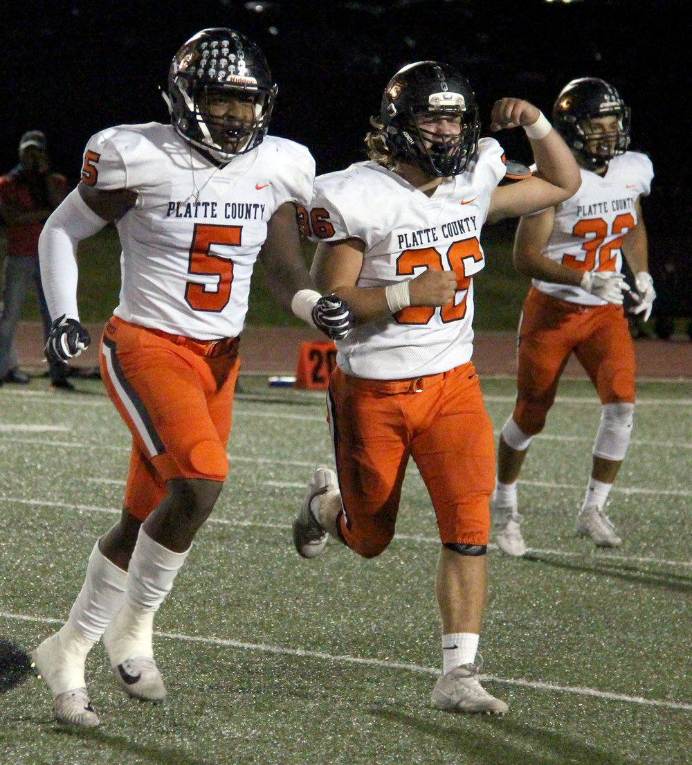 ROSS MARTIN/Citizen photo Platte County seniors Michael Smith (5) and Chase Blankenship (36) run off the field following a sack against Raytown South in a game Friday, Sept. 29 in Raytown, Mo. For more and a complete recap of sports, see Sports Weekly on pages B1-B8.