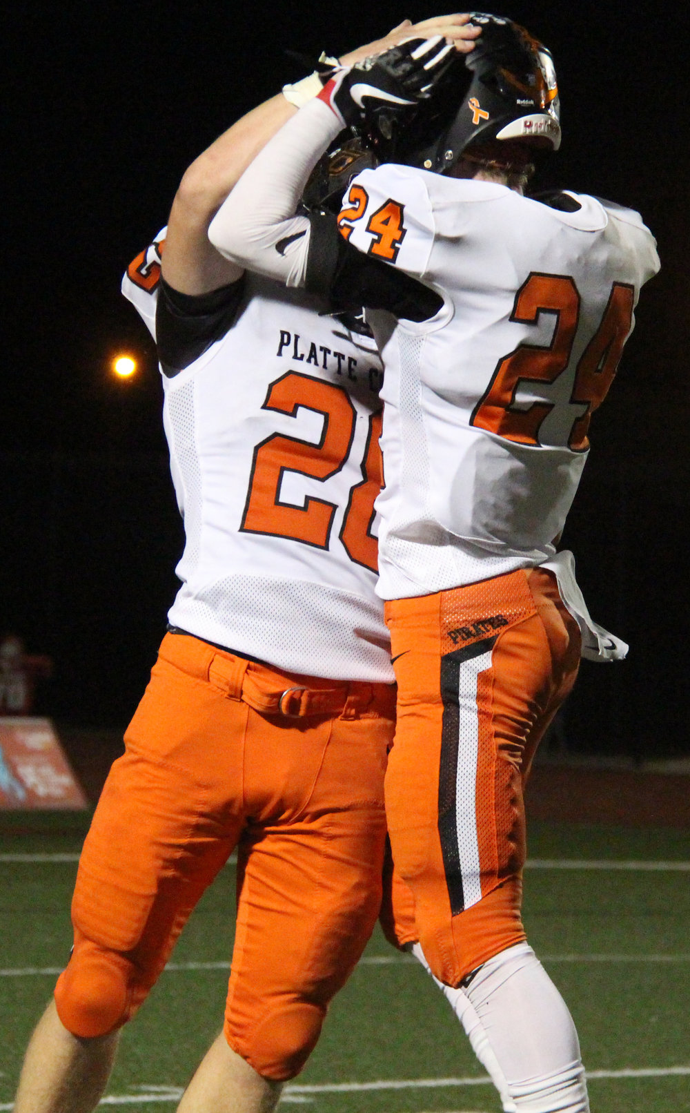 ROSS MARTIN/Citizen photo Platte County seniors Dakota Schmidt, left, and JP Post celebrate a fumble recovery in the first half.