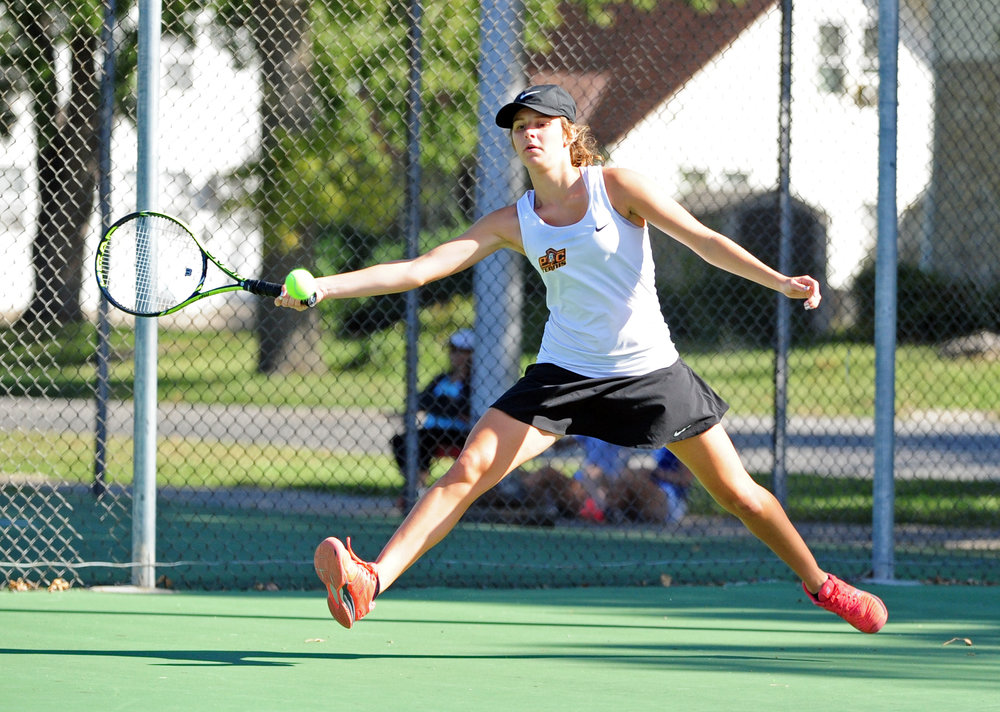NICK INGRAM/Citizen photo Platte County junior Hannah Valentine reaches to hit a forehand during a Class 2 District 16 singles match Friday, Sept. 29 in St. Joseph, Mo.