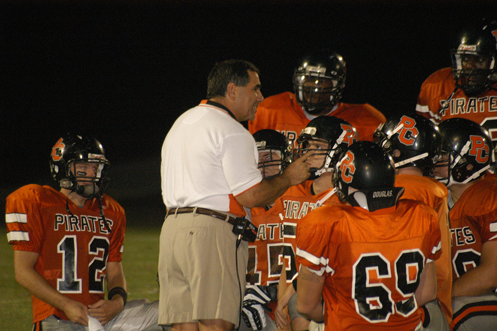 Citizen file photo Platte County football coach Chip Sherman talks to his team following the 2007 season opener. It turned out to be his final season with the Pirates, but the veteran leader will be honored with induction to the Missouri Hall of Fame this November.