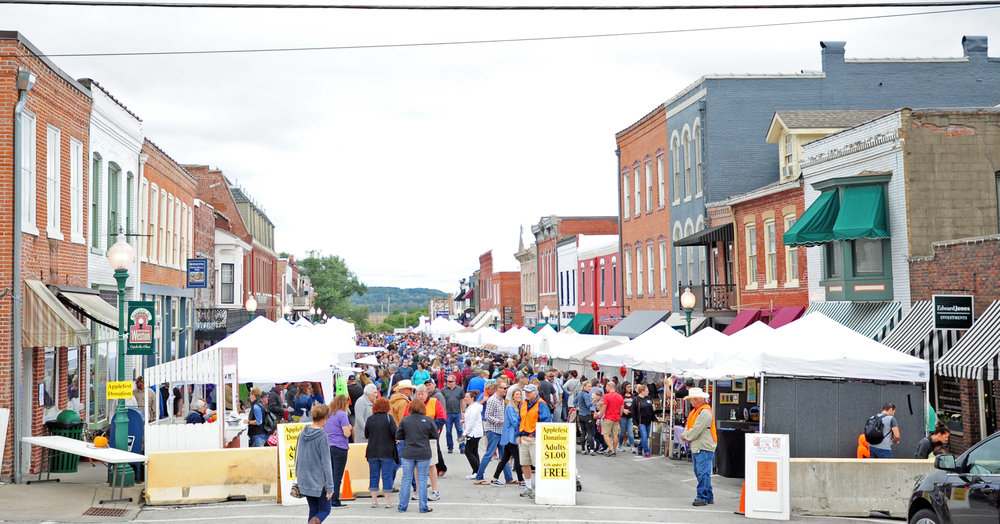 NICK INGRAM/Citizen photo Thousands of people crowded Main Street shortly after the parade to officially mark the beginning of the 29th annual Applefest on Saturday, Oct. 7 in Weston, Mo. The two-day event is the largest each year for the City of Weston.