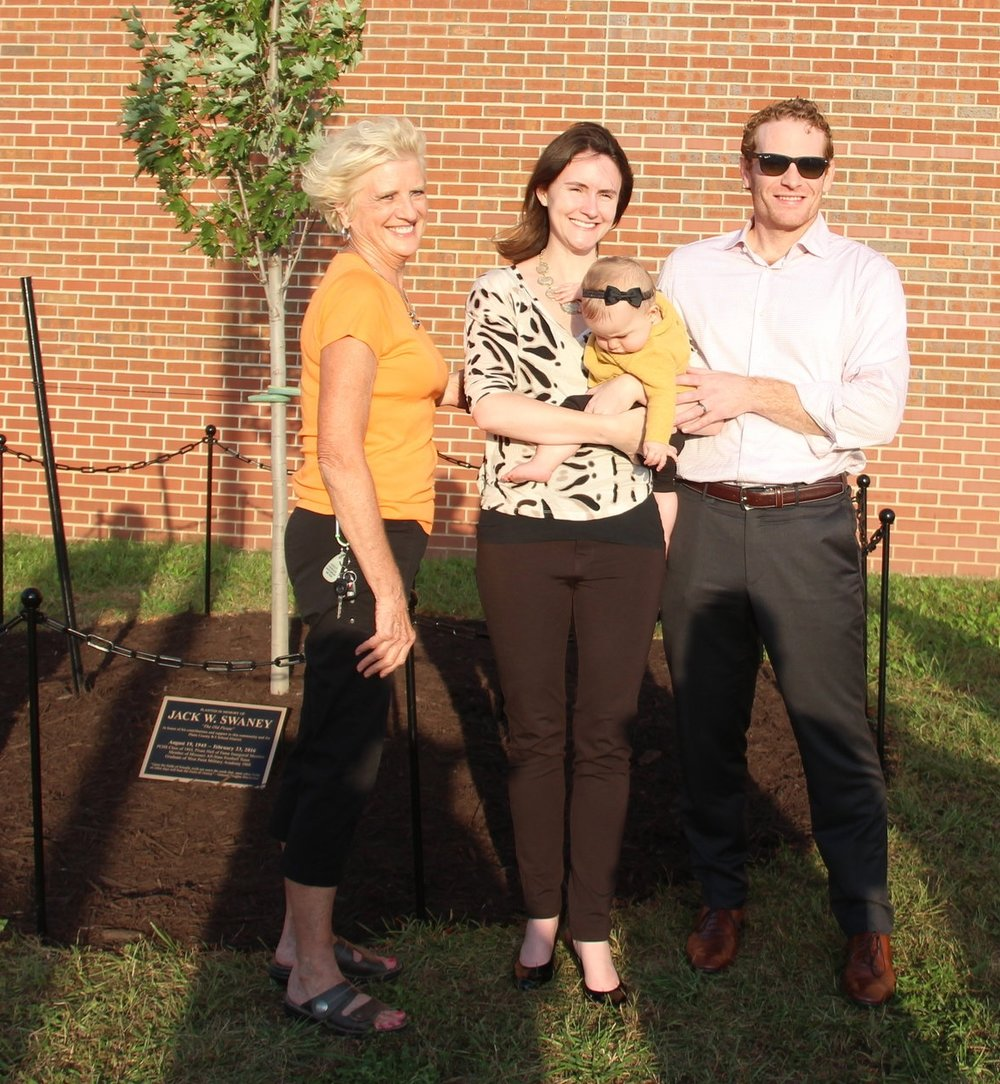 ROSS MARTIN/Citizen photo From left, Ruth Ann Swaney (widow), Lauren Swaney (daughter-in-law), Jane Elizabeth Swaney (granddaughter) and David Swaney (son) were family members on hand for a ceremony dedicating a tree near Pirate Stadium to the memory of Jack Swaney on Friday, Oct. 6.