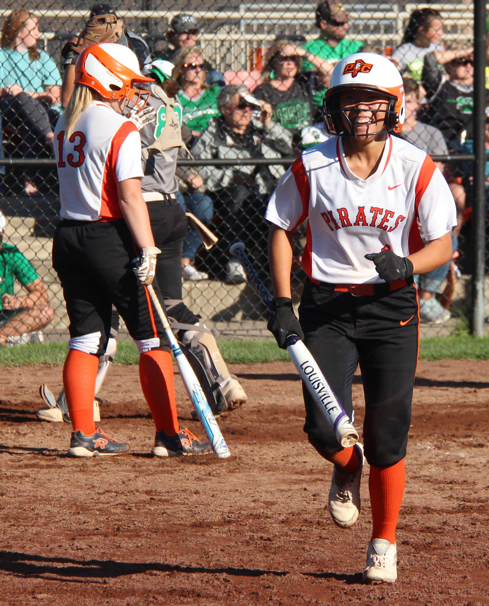 ROSS MARTIN/Citizen photo Platte County junior Stephanie Carroll, right, smiles after scoring a go-ahead run in the top of the seventh.
