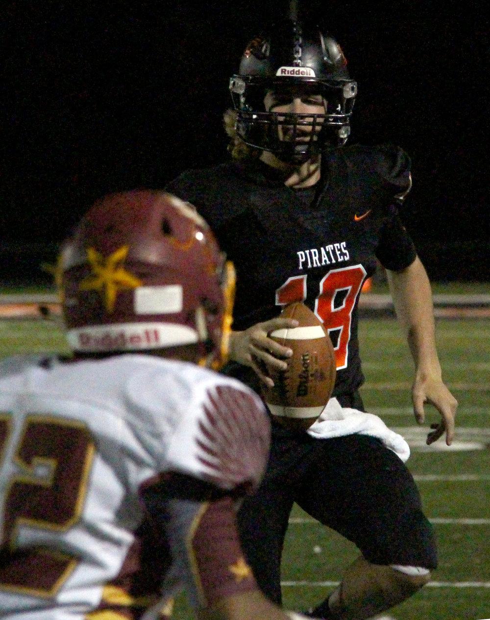 ROSS MARTIN/Citizen photo Platte County senior quarterback Tanner Clarkson looks for space to throw against Winnetonka.