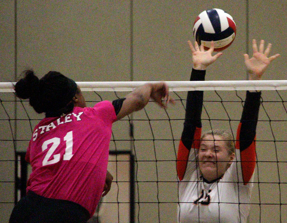 ROSS MARTIN/Citizen photo Platte County senior Lauren Walker (15) looks to make a block in the first set against Staley on Monday, Oct. 16 in Kansas City, Mo.