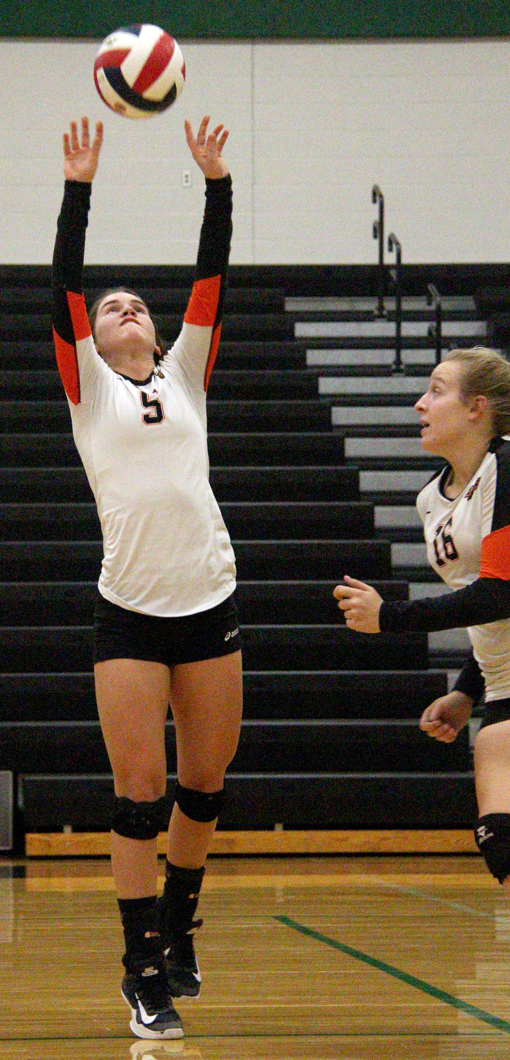 ROSS MARTIN/Citizen photo Platte County sophomore Ashley Bell hits a set in a Class 4 District 16 matchup with Staley on Monday, Oct. 16 at Falcon Fieldhouse in Kansas City, Mo.