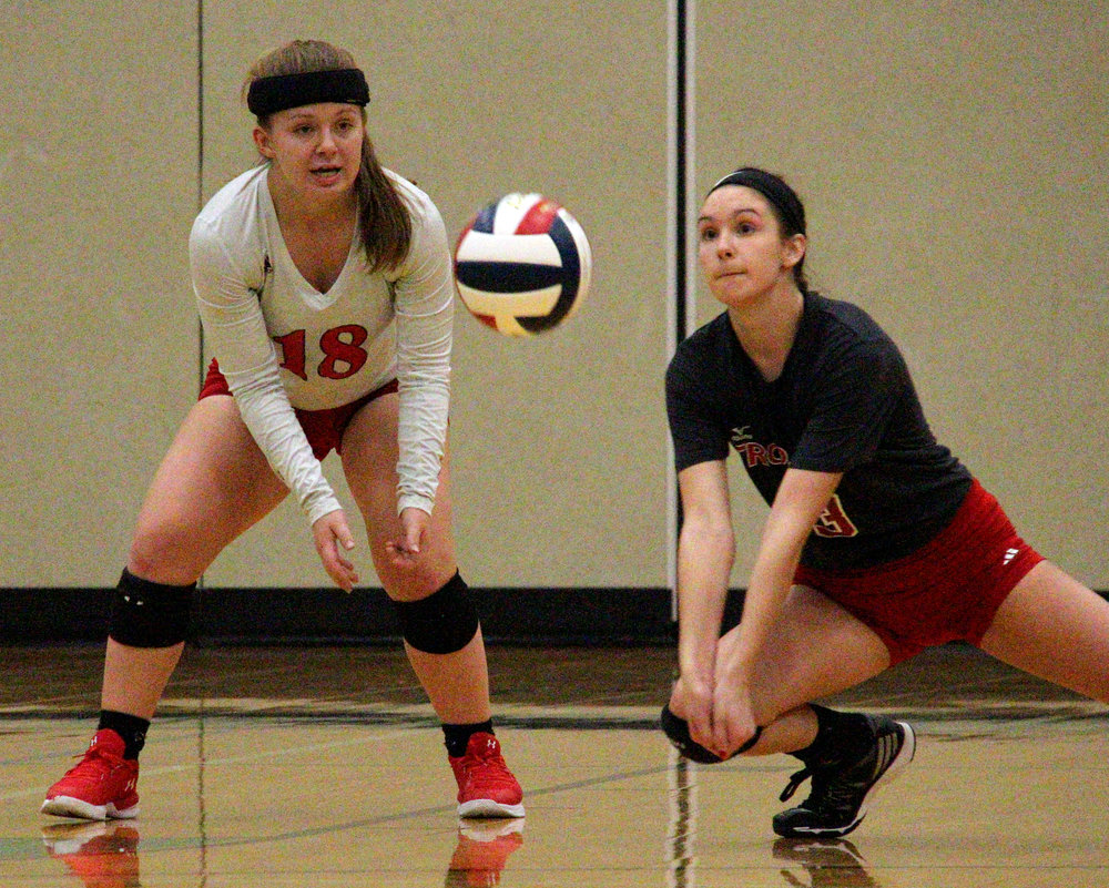 ROSS MARTIN/Citizen photo Park Hill seniors Madison Michaelis (18) and Kayla Huffman look to return a serve against North Kansas City on Monday, Oct. 16 in Kansas City, Mo.