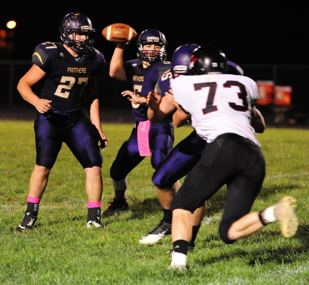 NICK INGRAM/Citizen photo North Platte sophomore quarterback Anthony Hernandez (5) looks to make a pass against Plattsburg.