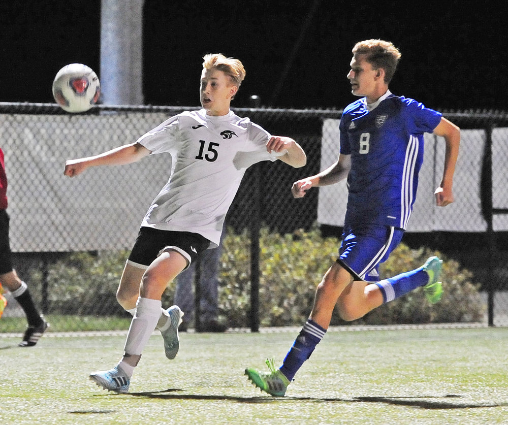 NICK INGRAM/Citizen photo Park Hill South sophomore Jacob Garza, left, looks to control the ball in front of a St. Joseph Central defender on Thursday, Oct. 12 at Park Hill District Soccer Complex in Riverside, Mo.