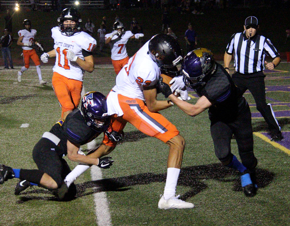 ROSS MARTIN/Citizen photo Platte County senior wide receiver John Watts, center, pushes over the goal line between two Kearney defenders for a touchdown on Friday, Oct. 13 in Kearney, Mo.