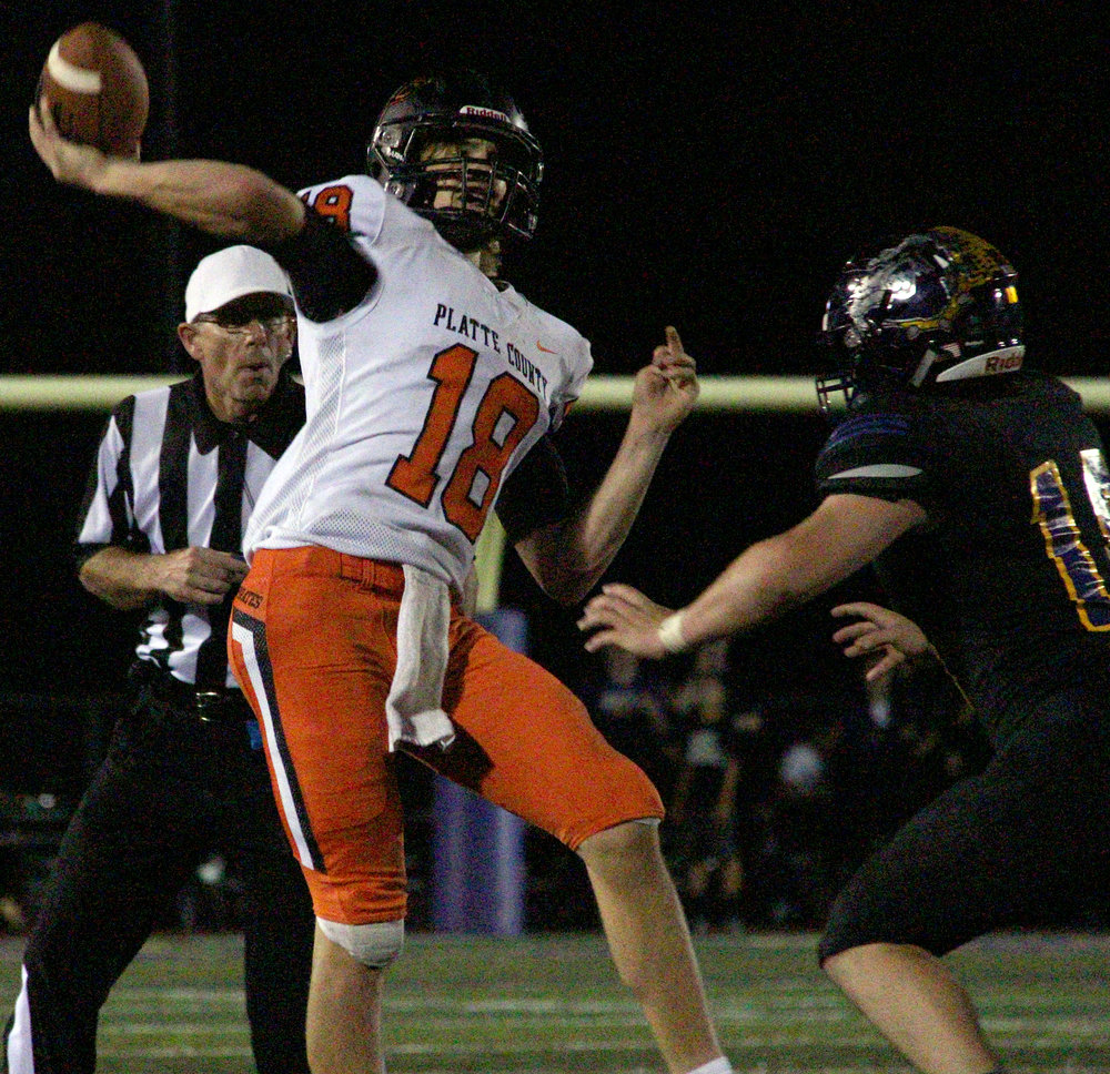 ROSS MARTIN/Citizen photo Platte County senior quarterback Tanner Clarkson lofts a pass downfield over a Kearney defender on Friday, Oct. 13.
