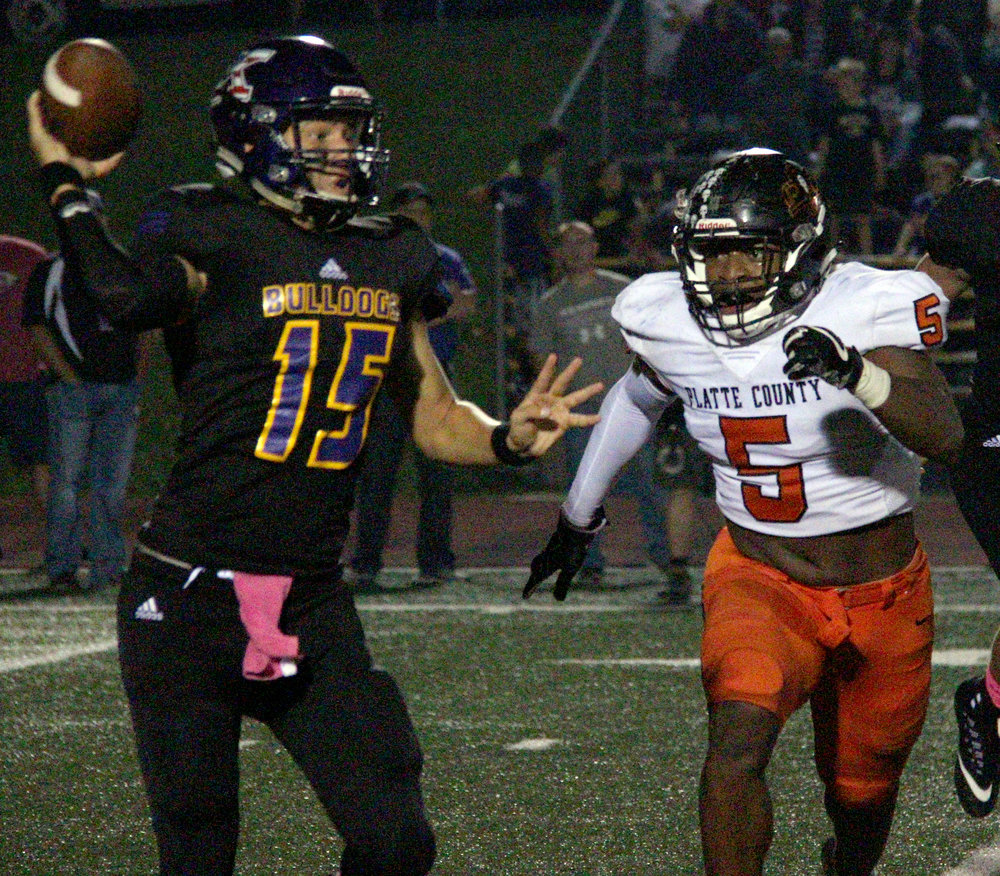 ROSS MARTIN/Citizen photo Platte County senior Michael Smith (right) chases Kearney quarterback Dakota Ah-Mu on Friday, Oct. 13.