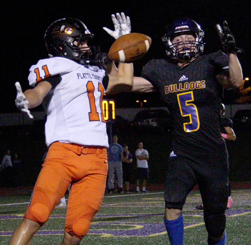 ROSS MARTIN/Citizen photo RIGHT: Platte County senior wide receiver Devin Richardson, left, looks to corral a pass Kearney's Hunter Gray (5) tipped during the first half at Kearney High School.