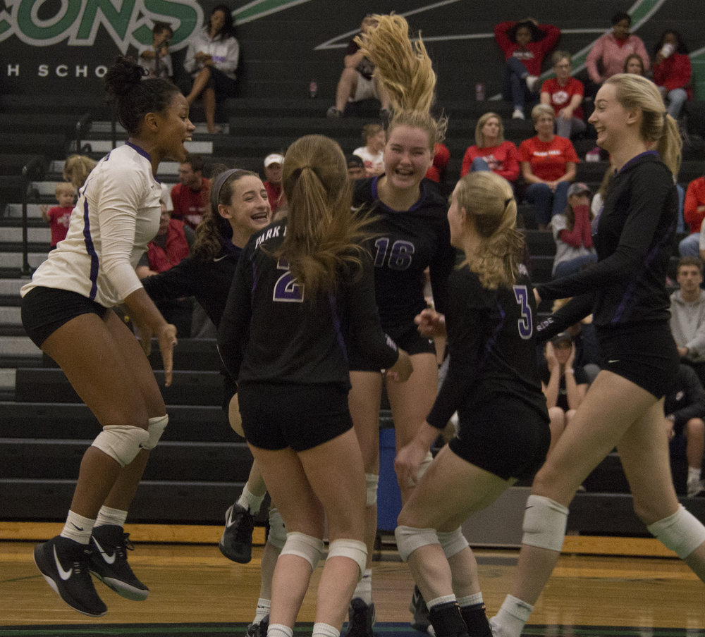 ROSS MARTIN/Citizen editor Park Hill South players celebrate the final point in a win over Park Hill in the Class 4 District 16 championship match Wednesday, Oct. 18 at Falcon Fieldhouse in Kansas City, Mo.