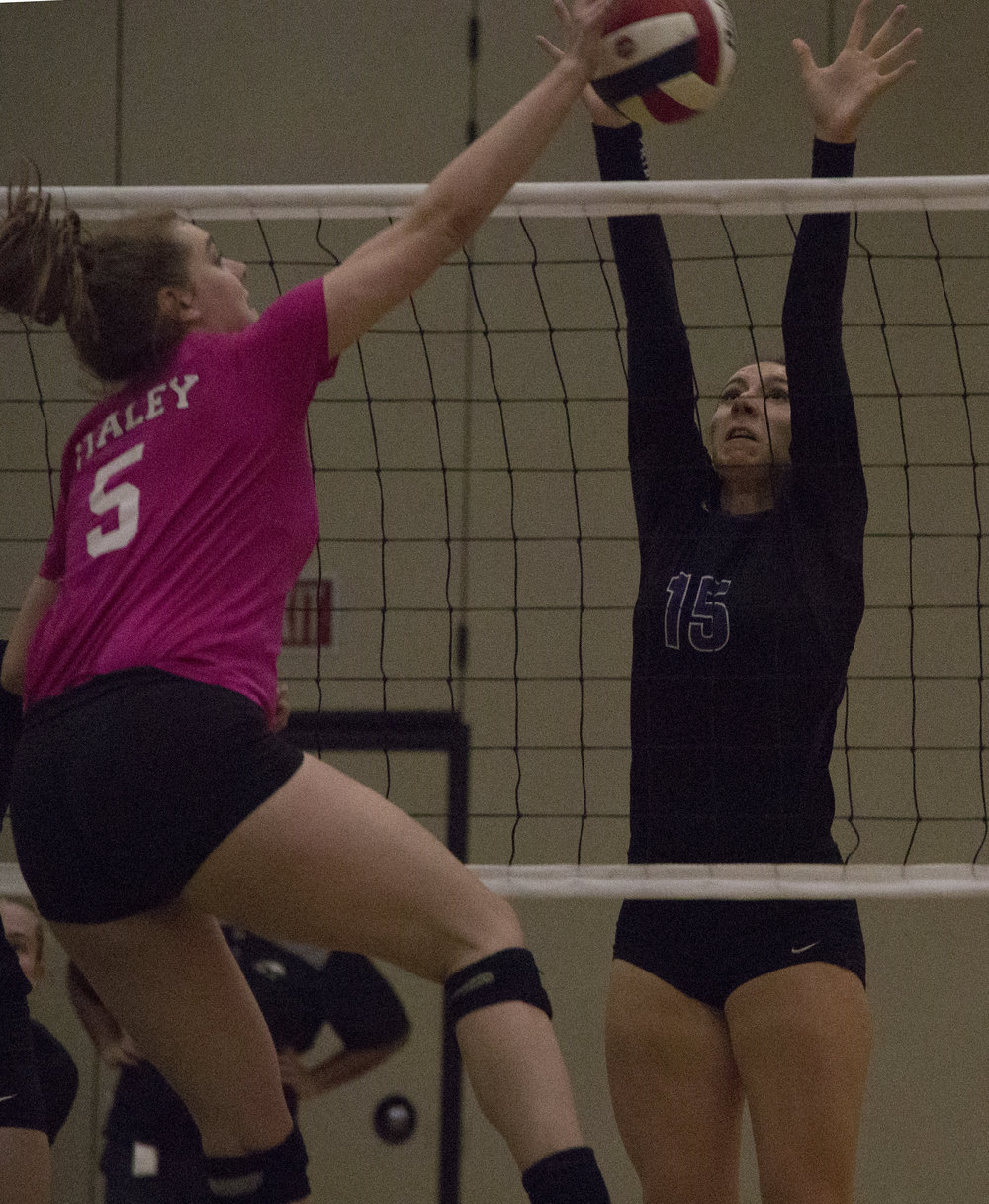 ROSS MARTIN/Citizen editor Park Hill South junior Michelle Dvorak, left, goes up for a block against Staley on Wednesday, Oct. 18.