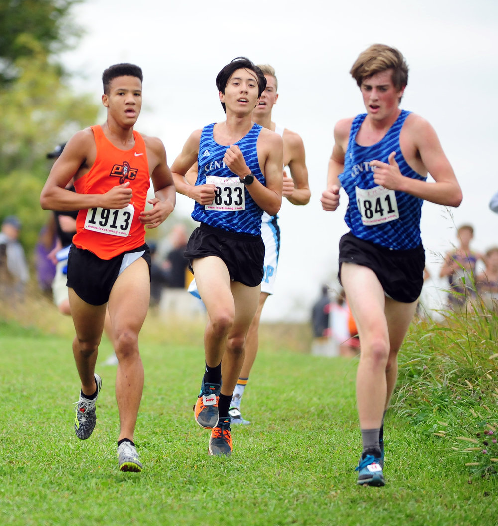 NICK INGRAM/Citizen photo Platte County junior Evan McPhatter, left, runs in a pack.