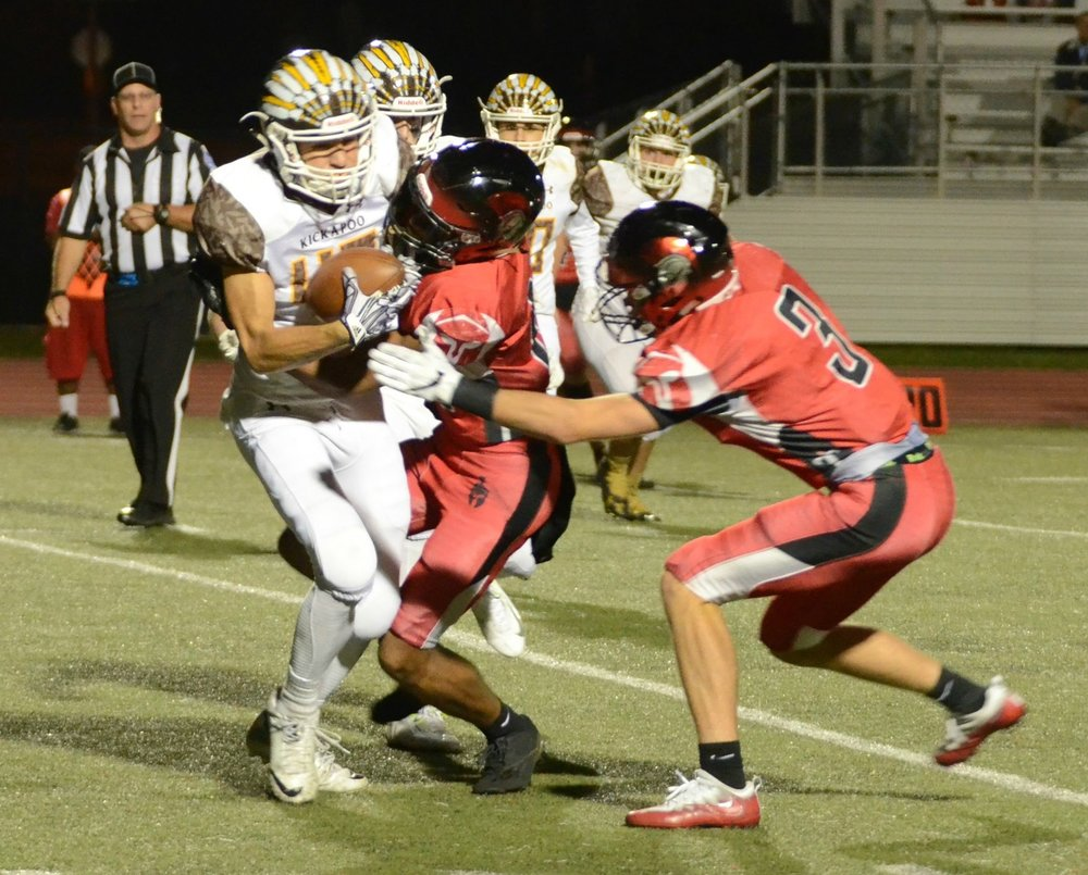 LEN LEHMANN/Special to The Citizen Park Hill senior defensive back Devin Haney (center) and junior defensive back Kolby Heinerikson (right) combine on a tackle against Kickapoo in a Class 6 District 4 matchup Friday, Oct. 20 at Park Hill District Stadium in Kansas City, Mo.
