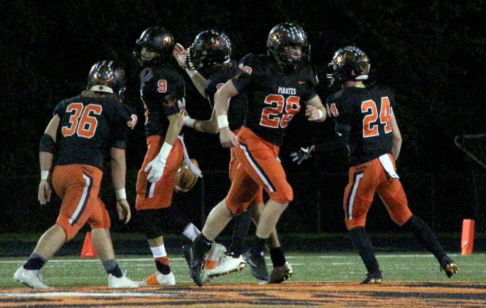 ROSS MARTIN/Citizen photo Platte County players celebrate an interception from Dylan Gilbert (9) during the first half of a Class 4 District 8 first round matchup with Benton on Friday, Oct. 20 at Pirate Stadium.