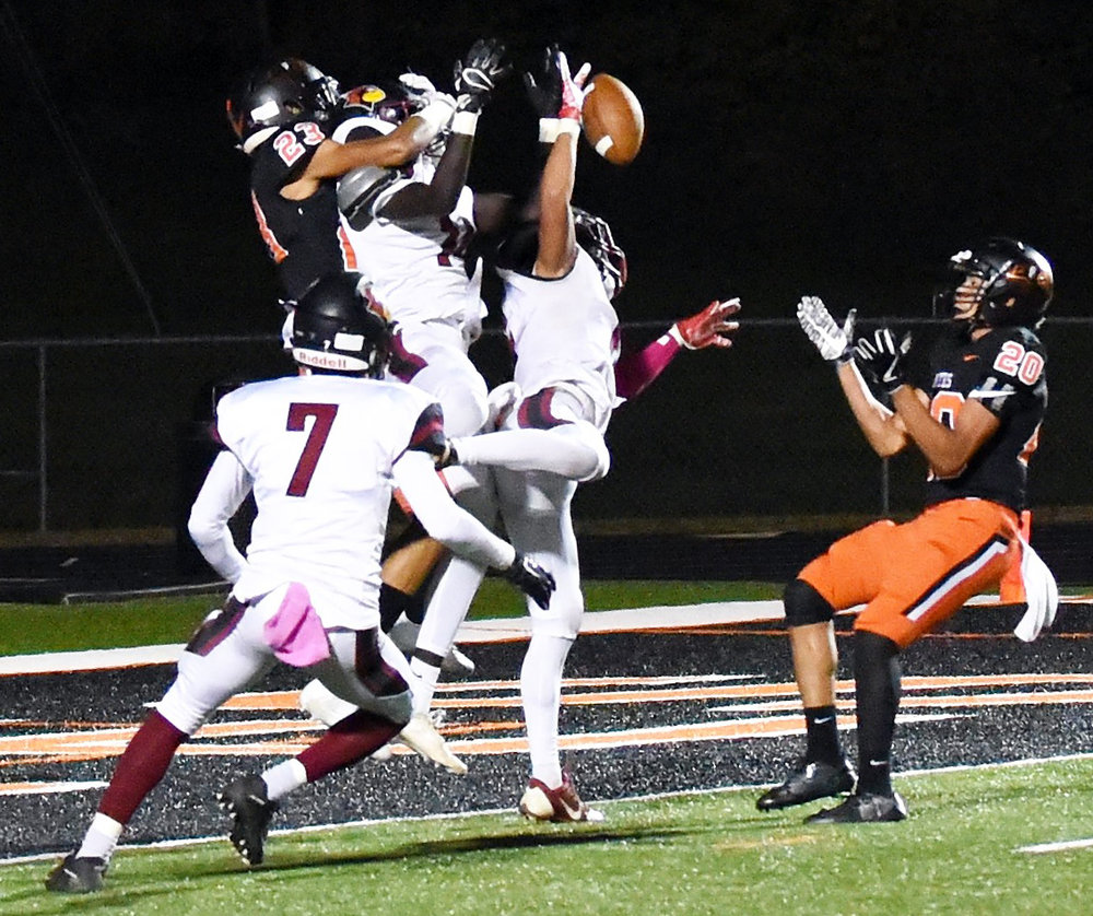MARSHALL BLAHA/Special to The Citizen Three Benton defenders go up and deflect a pass that Platte County junior wide receiver Brice Bertram (20) caught for a touchdown on Friday, Oct. 20 at Pirate Stadium.