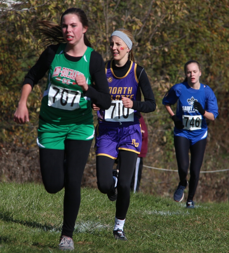 ROSS MARTIN/Citizen photo North Platte senior McKenna Fulton, center, comes up the final hill during the Class 2 District 8 meet Saturday, Oct. 28 at Jesse James Fairgrounds in Kearney, Mo.