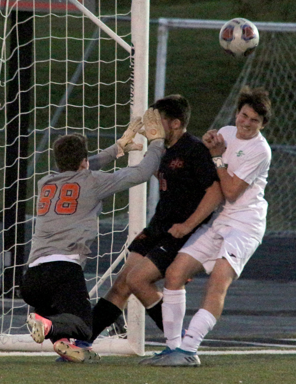 ROSS MARTIN/Citizen photo Platte County senior goalkeeper Turner Hess (88) punches a loose ball away against Smithville on Wednesday, Oct. 25 in Smithville, Mo.