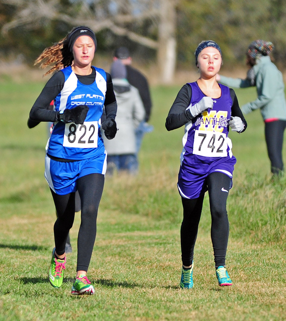 NICK INGRAM/Citizen photo West Platte freshman Lexi Elmore, left, runs in the Class 1 District 8 race Saturday, Oct. 28 at Smith's Fork Park in Smithville, Mo. The Bluejays won the team title to earn the first team berth to the Class 1 Missouri State Cross Country Championships since 2012..